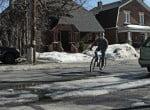 cyclist-turning-with-potholes-etc