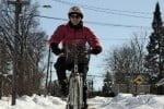 pink-cyclist-riding-close-up_