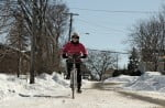 pink-cyclist-riding-front-view_