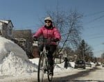 pink-cyclist-riding-on-clear-part-of-road